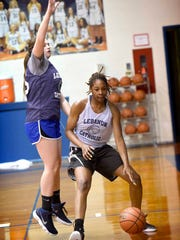 Alexis Hill, the reigning Class 1A state player of the year, practices for the upcoming 2017-18 season.