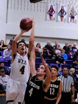 Wylie's Austin Brewer (4) gets fouled going to the basket by Big Spring's Logan Edwards (4) during the game on Friday, Jan. 16, 2018. The Bulldogs won 80-45.