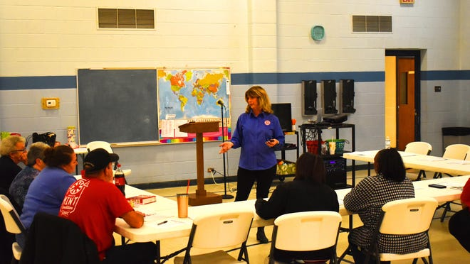 Salvation Army divisional emergency disaster services director Laurie Fried leads a class on proper food handling. Volunteer training before a disaster makes it possible for workers to be immediately dispatched to areas in need.