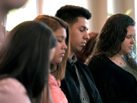 Lipscomb University student Luis Vargas,center, and