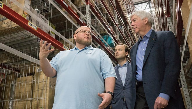 Warehouse manager Shawn Westlund gives a tour to Governor Rick Snyder, Lt. Governor Brian Calley and others.