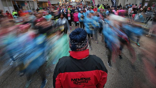 Runners line up downtown for the 15th annual St. Jude Memphis Marathon Saturday morning. As the largest single fundraisng event for St. Jude Children's Research Hospital, organizers were expecting over 22,000 runners at this years event.