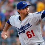Josh Beckett, facing surgery for a torn labrum in his left hip that caused him to miss most of the last three months of the season, has retired at 34, ending a 14-year career that included two World Series championships. He announced his decision to retire in St. Louis after the Dodgers were eliminated in the National League Division Series on Tuesday.