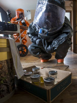 Iowa National Guard Civil Support Team members work the scene of a mock chemical and biological lab Tuesday in Des Moines.