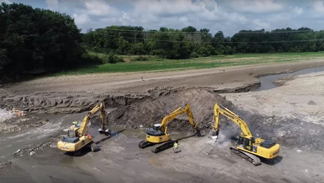 Demolition crews continue to grind away remaining pieces of the Ballville Dam as the Sandusky River flows through a new channel just as engineers had predicted.