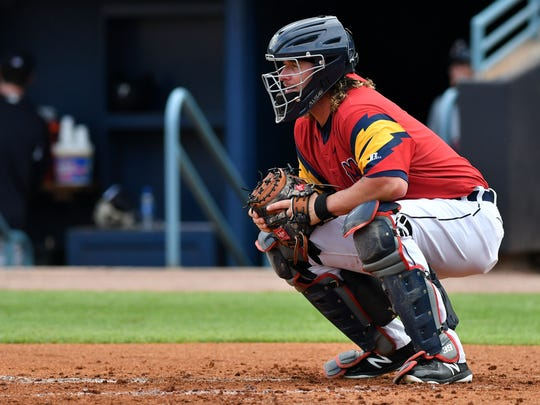 Jarrod Saltalamacchia has been teaching the young catchers in Toledo how to call a game.