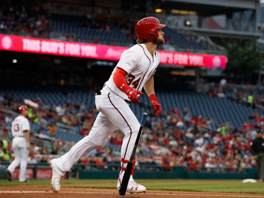 Washington Nationals right fielder Bryce Harper (34) follows the ball during the first inning of a baseball game against the Seattle Mariners in Washington, Wednesday, May 24, 2017. (AP Photo/Manuel Balce Ceneta)