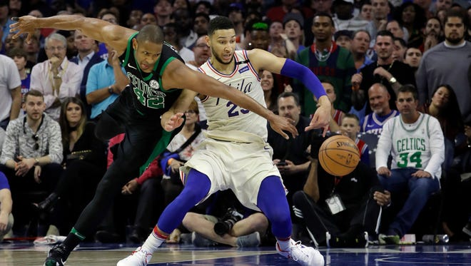 Boston Celtics' Al Horford, left, and Philadelphia 76ers' Ben Simmons chase the ball during the second half of Game 3 on Saturday.
