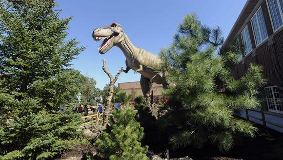 Mama T-Rex, a life-sized animatronics dinosaur greets