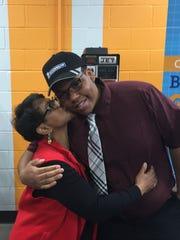 Terri Harper congratulates her son, Johnathan, during