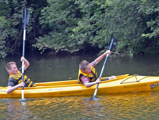 Anthony, 12, and Elijah, 10, Lawless of West York paddle