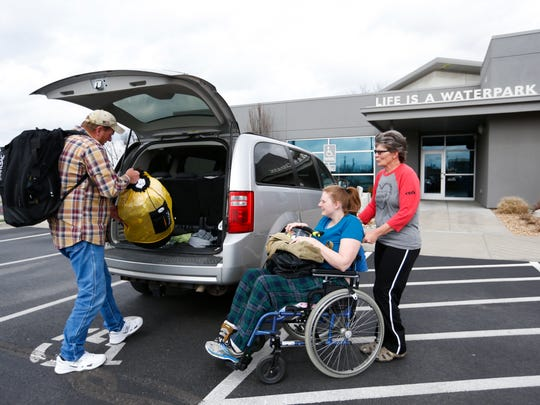 Caitlin Moffett and her parents Dave and Frankie Moffett arrive at DiVentures to practice SCUBA diving. Caitlin has a form of muscular dystrophy called Friedreich's ataxia, an inherited genetic disorder that slowly damages a person's nervous system, causing muscles to wither and a loss of control in arms and legs.