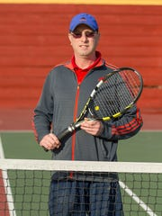 Ithaca High School tennis coach Arthur Falkson