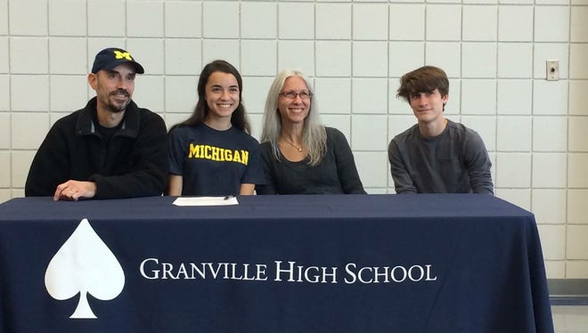 Granville senior Micaela DeGenero posed with her family after signing a national letter of intent to run track and cross country for the University of Michigan.