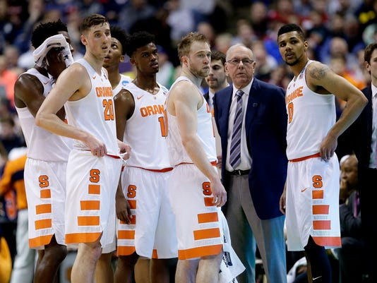 Syracuse head coach Jim Boeheim stands with his players while a play is reviewed during the first half of a second-round men's college basketball game against Middle Tennessee in the NCAA Tournament, Sunday, March 20, 2016, in St. Louis. (AP Photo/Charlie Riedel)