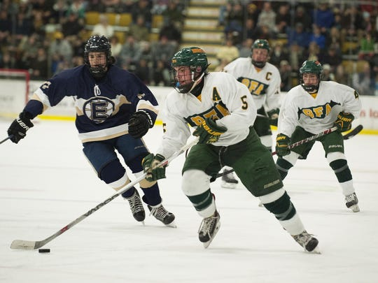 Bobwhites forward Matt Needleman (5) looks to take a shot during the Vermont state boys division I high school hockey championship game between the Essex Hornets and the BFA St. Albans Bobwhites at Gutterson Fieldhouse on Thursday in Burlington.