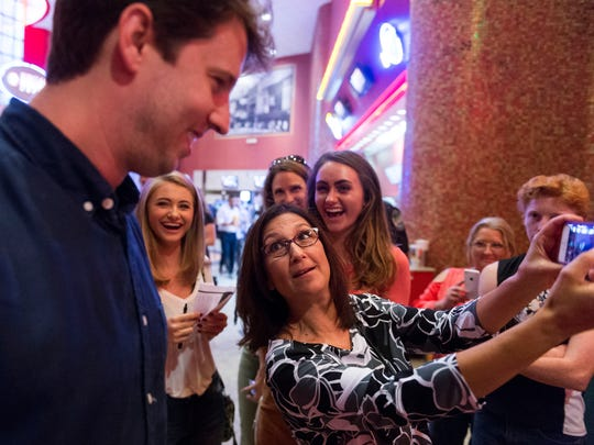Sandra Robledo takes a photograph of herself and actor Jon Heder during the premier of The Tiger Hunter at the Regal Riviera theater on Monday, September 18, 2017.
