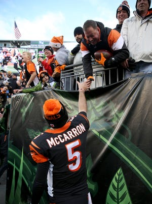 Bengals quarterback AJ McCarron gives a football to a fan after the Bengals beat the Ravens on Sunday.