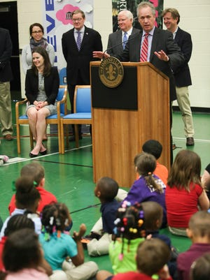 "Mayor Greg Fischer speaks in the Portland Elementary gymnasium during an announcement about the new college fund for Portland Elementary students called ""Louisville Goes to College."" Students will be getting $100 put into a college fund for them every year from kindergarten until high school graduation. March 28, 2016"
