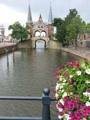 In southern Friesland, Sneek is a city of canals highlighted by the Waterpoort, a fortified gate.
