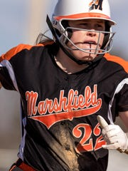 Megan Donahue, starting pitcher for the Marshfield Tigers, makes a run for third base against Eau Claire North at the Marshfield Fairgrounds Park on April 17,.