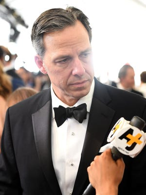 CNN's Jake Tapper spends some time on the other side of the microphone, taking questions from reporters on the purple carpet. We wouldn't be surprised if several asked him about being spoofed on 'Saturday Night Live.'