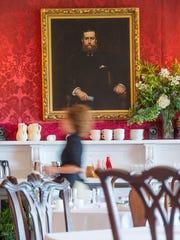 A portrait of Willian Seward Webb overlooks the dining