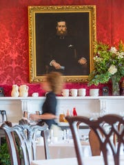 A portrait of Willian Seward Webb overlooks the dining room at The Inn at Shelburne Farms in Shelburne. Seen on Tuesday, August 22, 2017.