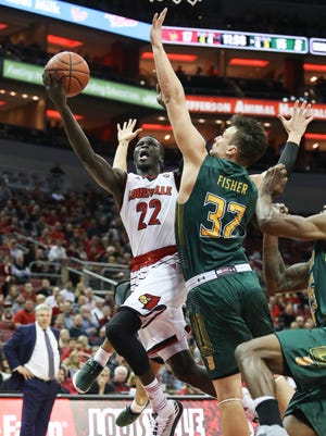 U of L's Deng Adel drives to the basket during the first half against the visiting Siena Saints on Wednesday evening at the KFC Yum! Center. Dec. 6, 2017