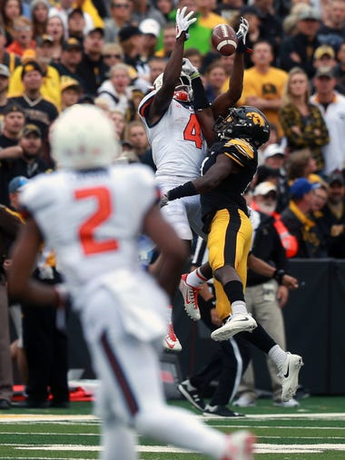 Iowa's Michael Ojemudia breaks up a pass intended for