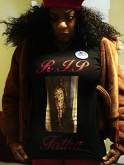 Courtney Arnold wears a commemorative T-shirt with Benny Barefield's picture on it.