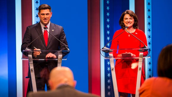 Republican U.S. Senate candidates Kevin Nicholson and Leah Vukmir stand at their podiums at the start of a debate at the University of Wisconsin-Milwaukee last month.