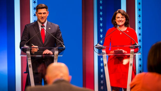 Republican U.S. Senate candidates Kevin Nicholson and Leah Vukmir prepare to debate at the University of Wisconsin-Milwaukee.
