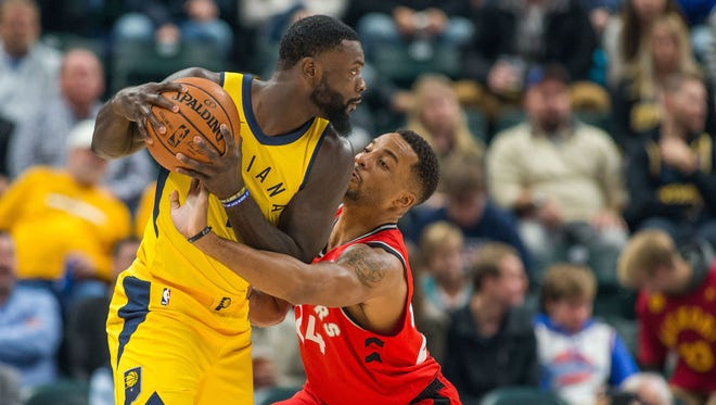 Indiana Pacers guard Lance Stephenson (1) holds the ball against Toronto Raptors forward Norman Powell (24) in the first half at Bankers Life Fieldhouse.