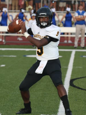 Starkville's Malik Brown drops back to pass against Oxford.