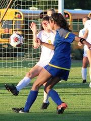 Marian sophomore forward Kate Hughes (15) bends a shot