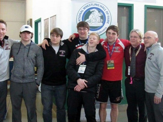 Dave Buck, second from right, with Elmira coach Dave