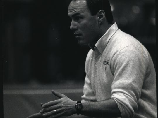 Hartford Coach Don Kreuser gestures to one of his wrestlers in 1991.