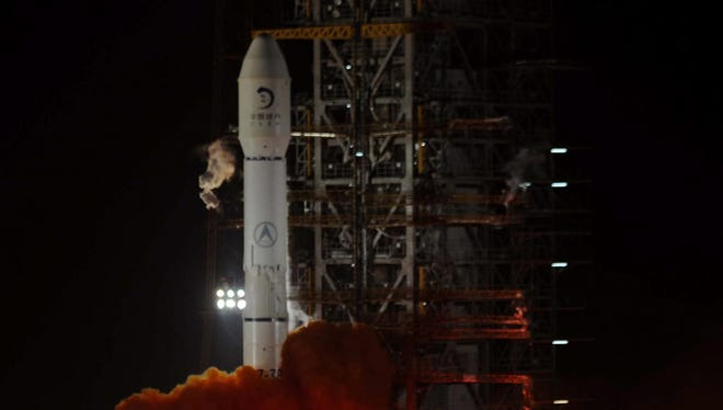 A photo from Dec. 2, 2013, shows the Long March carrier rocket, the vehicle for China's first moon rover mission, blasting off after midnight in Xichang in southwest China's Sichuan province.  China on Dec. 14 that the craft carrying a robotic rover Yutu successfully landed on the surface of the moon.