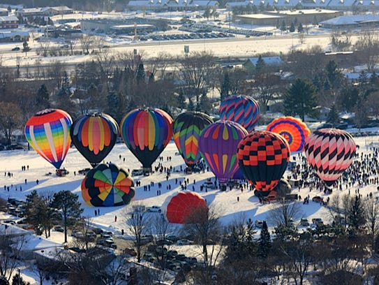 Hot air balloons prepare to launch from Hudson during