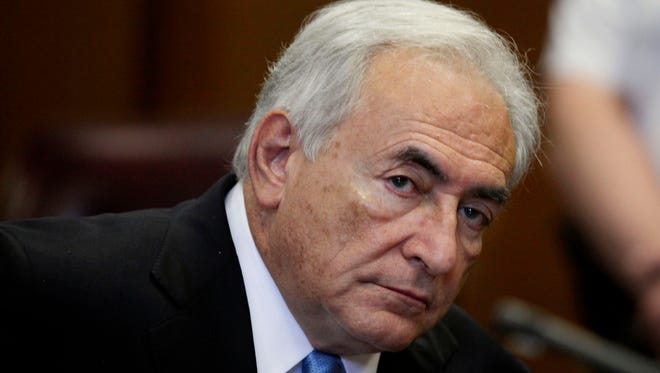 Dominique Strauss-Kahn listens to proceedings in New York State Supreme court in July 2011. Strauss-Kahn defended himself in court on charges of aggravated pimping.