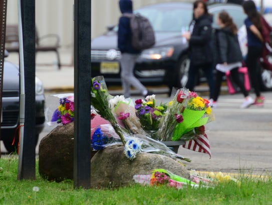 A memorial of flowers outside East Brook Middle School