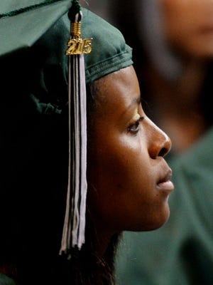 Kenyoua Davis listens to a speaker during the Bossier High School commencement exercises last spring at the CenturyLink Center.