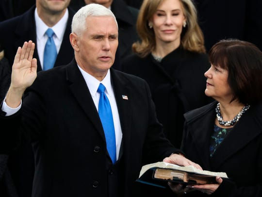 Vice President Mike Pence is sworn in as his wife,