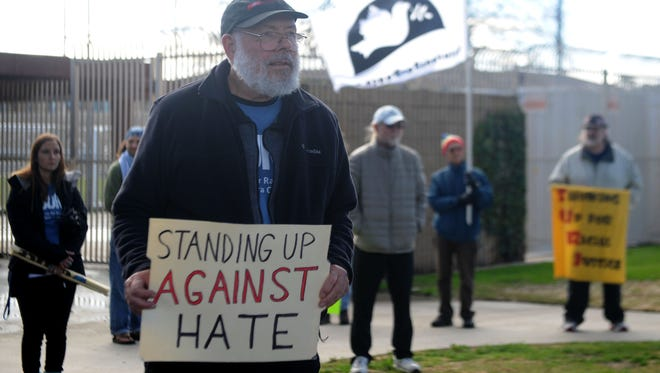 Gordon Clint, of Newbury Park, joins in the  United Against Hate protest from Del Sol Park to Plaza Park in Oxnard. Participants were protesting President Donald Trump, who was sworn-in Friday.