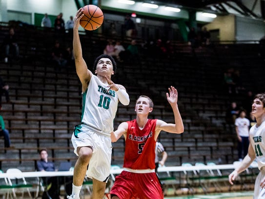 Yorktown's Matt Grimes goes in for a layup against Blackford during their sectional game at New Castle High School Tuesday, Feb. 27, 2018.