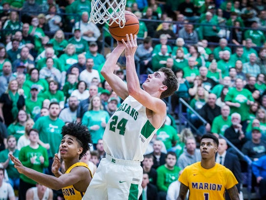 New Castle's Nicholas Grieser goes up for a layup against Marion in their regional championship game at Marion High School Saturday, March 10, 2018.