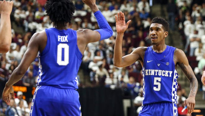 Kentucky Wildcats guard Malik Monk (5) celebrates with guard De'Aaron Fox (0) after a play during the second half against the Texas A&M Aggies at Reed Arena on March 4.