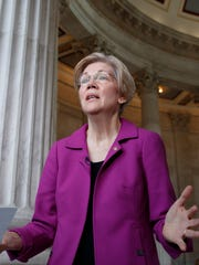 Holding a transcript of her speech in the Senate Chamber, Democratic Sen. Elizabeth Warren of Massachusetts reacts to being rebuked by the Senate leadership and accused of impugning a fellow senator, Sen. Jeff Sessions, R-Ala., the attorney general nominee, on Capitol Hill in Washington, Wednesday, Feb. 8, 2017. Warren was barred from saying anything more on the Senate floor about Sessions after she quoted from an old letter from Martin Luther King Jr.'s widow about Sessions.