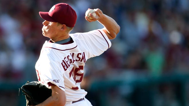 FSU's Boomer Biegalski pitches against College of Charleston during their NCAA Regional game at Dick Howser Stadium on Saturday.